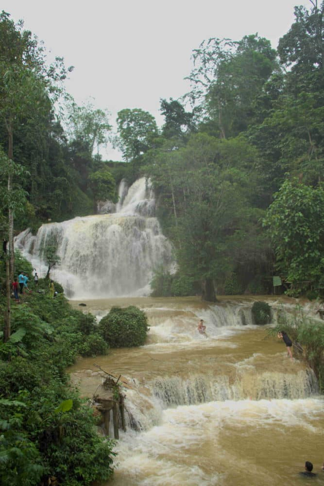 A brown coloured waterfall after rain during the wet season