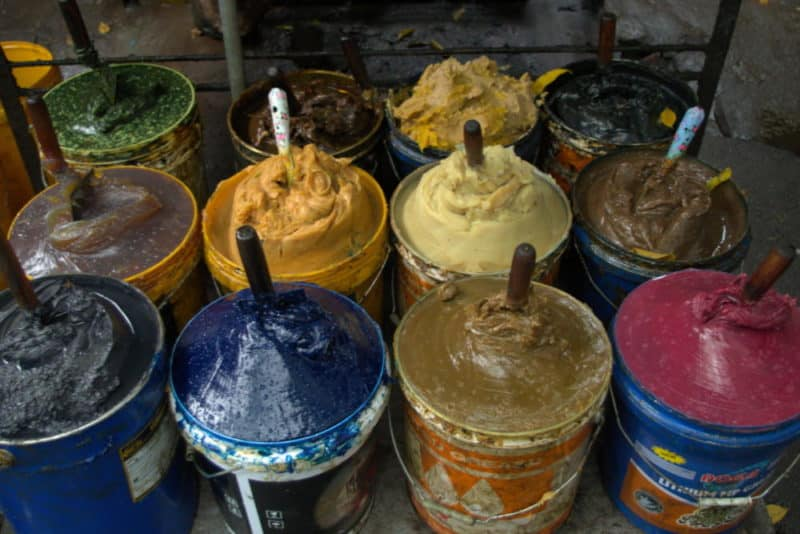 Buckets of colored grease that looks like ice cream