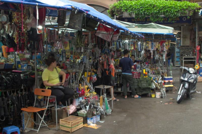 outdoor market stalls selling hand tools