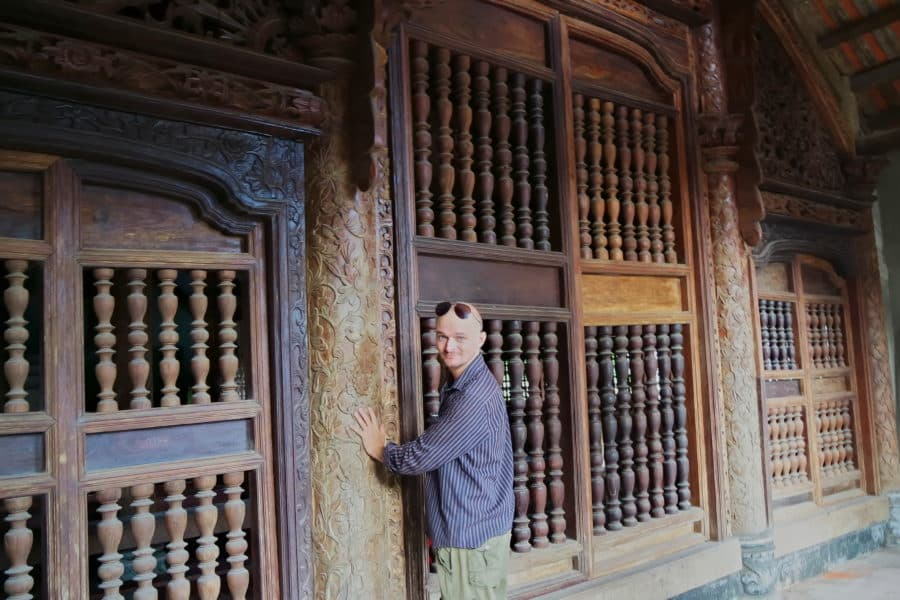 Hand carved wooden doors and pillars at Phat Diem Cathedral