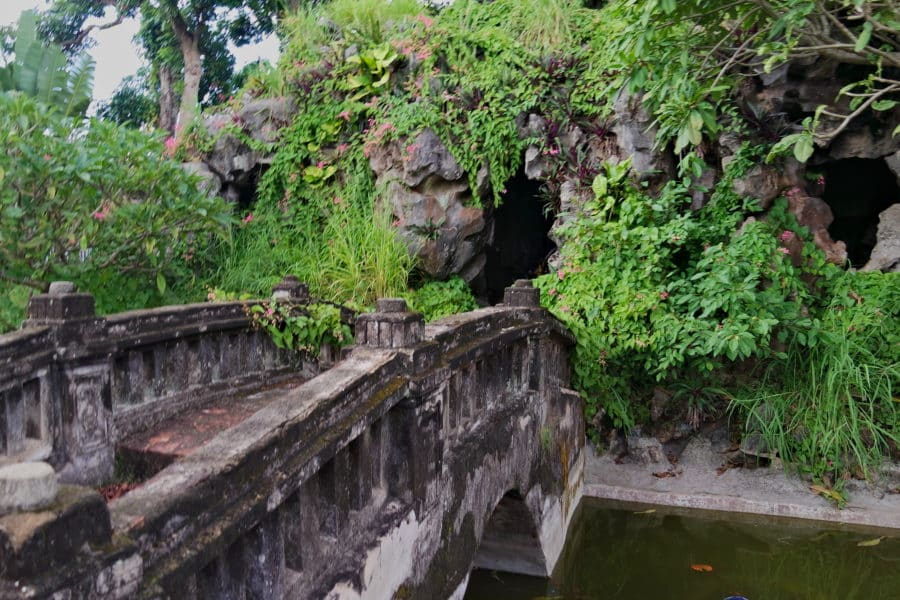 Bridge to a cave with an altarin Nam Dinh, Vietnam, a motorbike tour destination