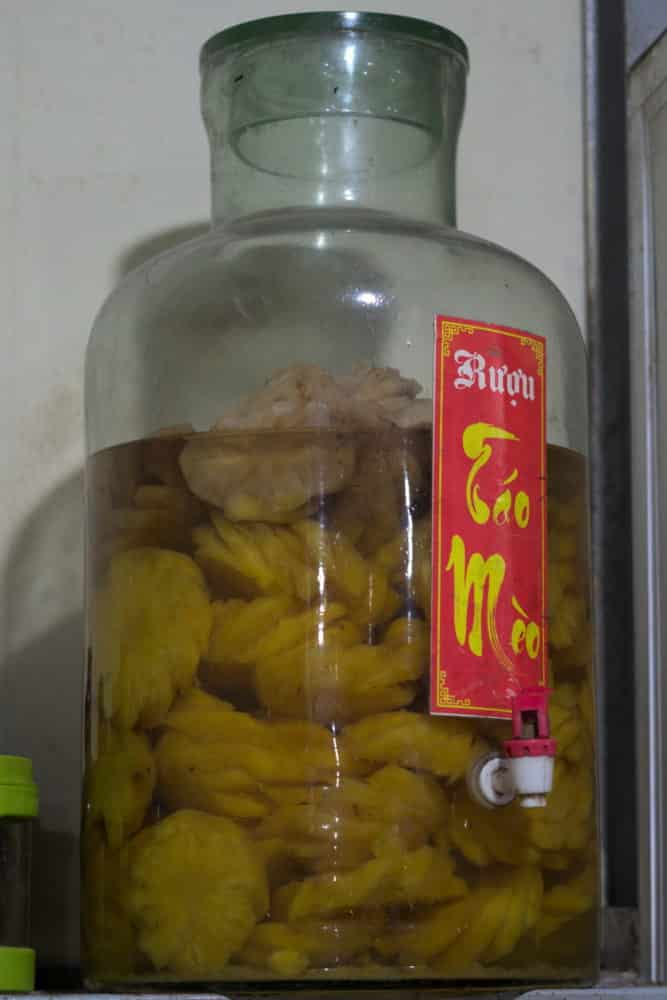 Pineapple in a glass jar of rice wine