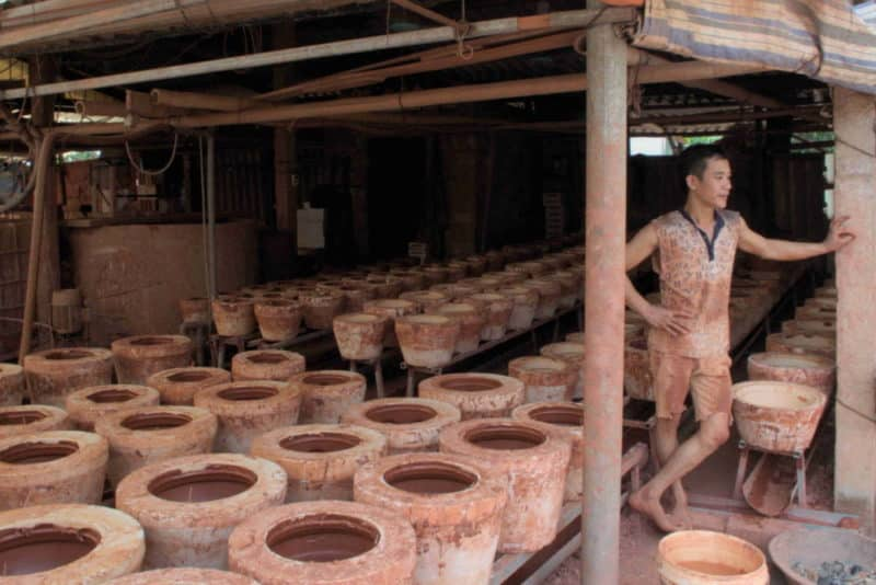 A man working in a clay pottery factory in Vietnam