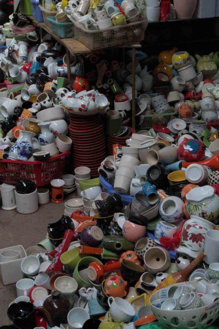 Piles of cheap ceramic pottery cupsand vases at Bat Trang village, Vietnam