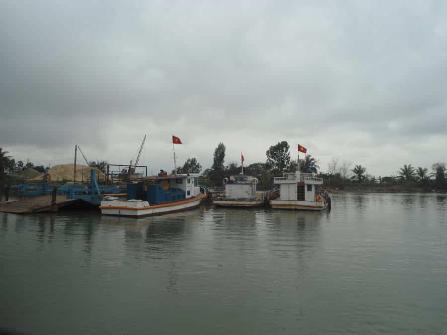 Boats floating in a river in Hai Phong