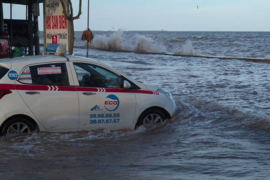 Taxi bogged in seawater and cant get out