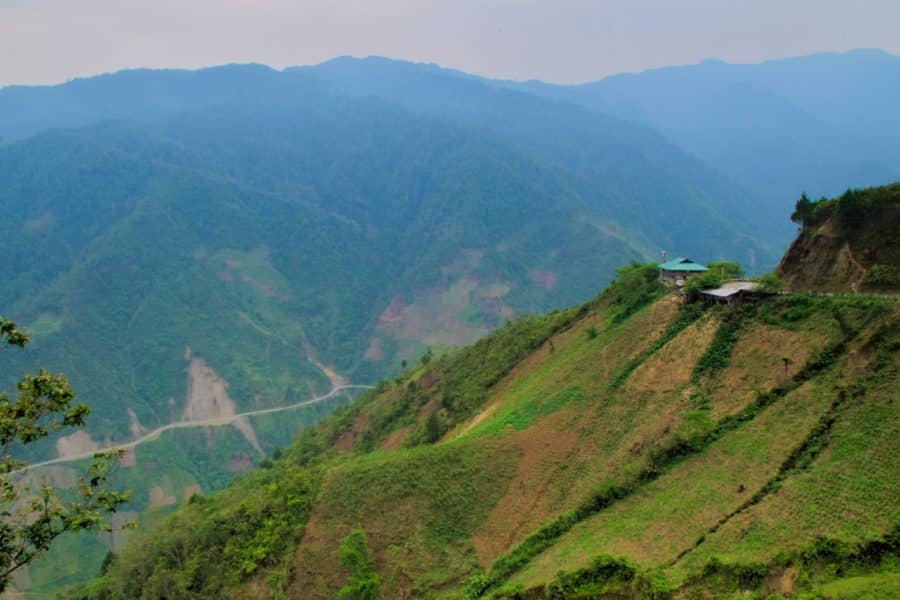 House on the edge of a mountain at Khau Pha pass in northern Vietnam