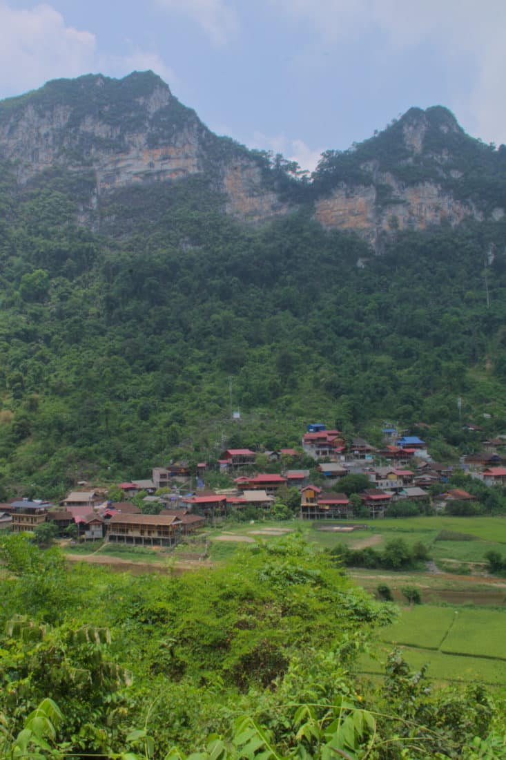 A Tay minority village nestled beneath a limestone mountain and jungle in Northern Bac Kan