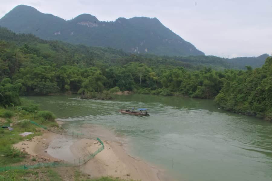 Boat on the river at the gate of Ha Giang city during a motorbike tour