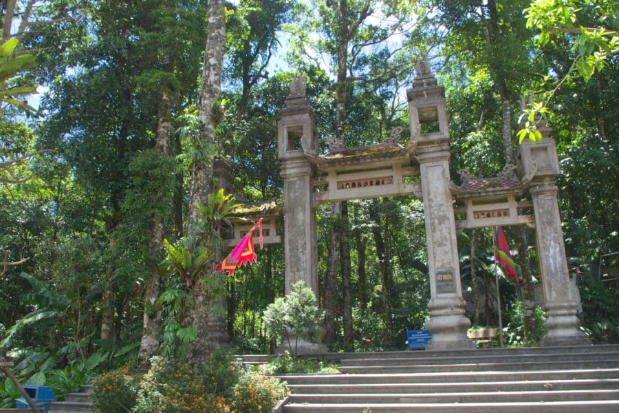 A large stone gateway for a jungle path leading to a temple