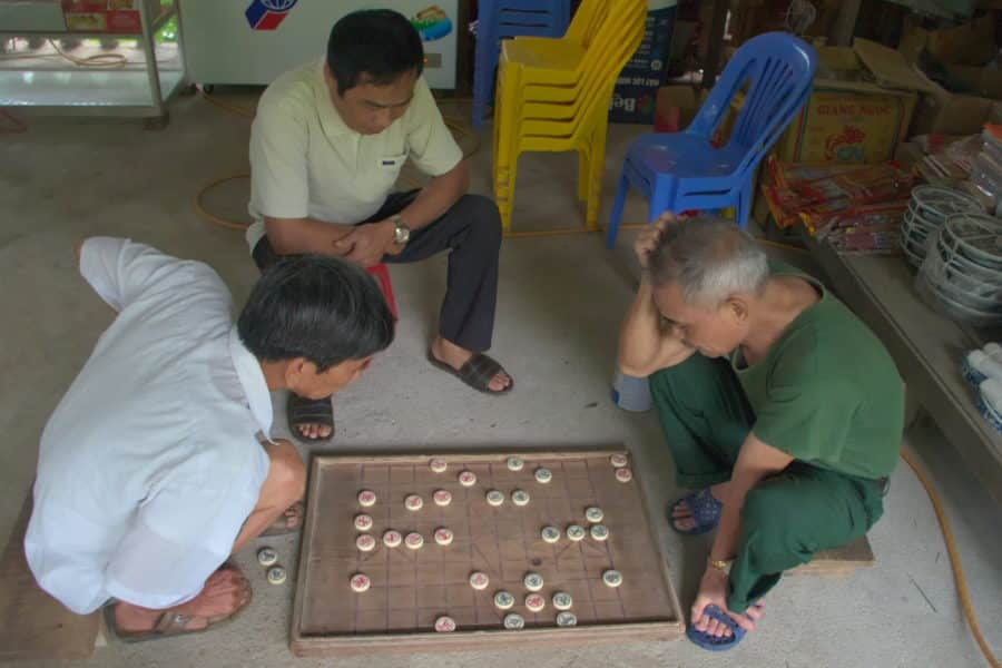 Men playing chess south of Ha Giang city we met on a motorbike tour