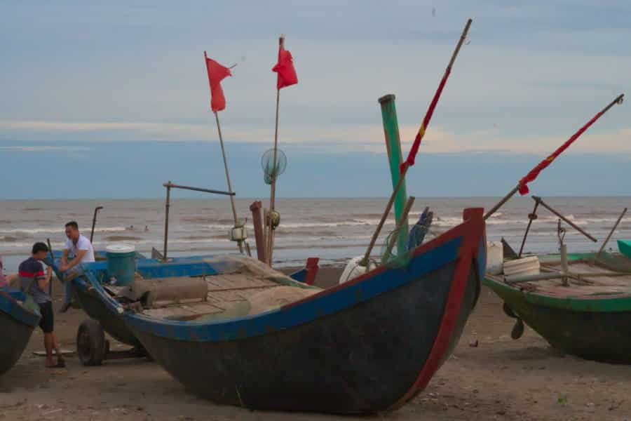 Fishing boats on the coast of Nam Dinh as seen on a motorbike tour with viettracks