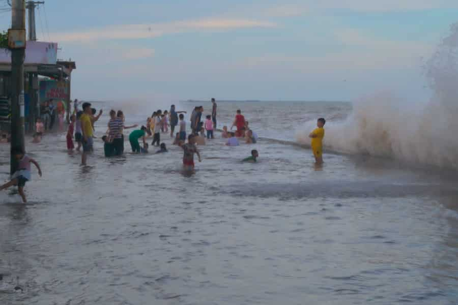 Nam Dinh locals swimming at king tide in northern Vietnam