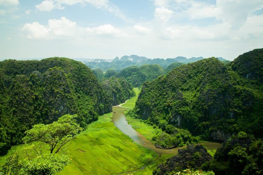 Boats on the river at Tam Coc in Ninh Binh a motorbike tour destination in Vietnam