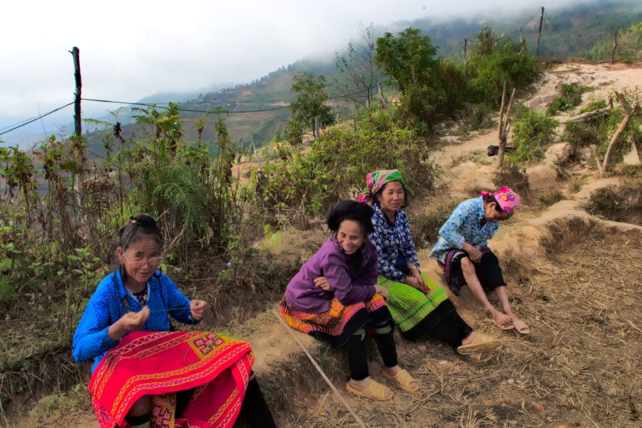 Vietnamese women relaxing on a mountain ridgein Xim Vang, Son La