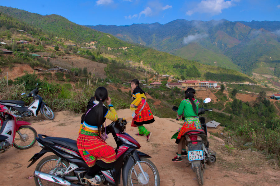 Muong minority girls on motorbikes in the Mountains of Vietnam
