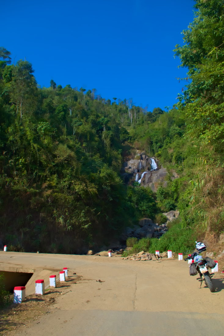Roadside waterfall with a honda xr motorbike in Xin Vang, Son La