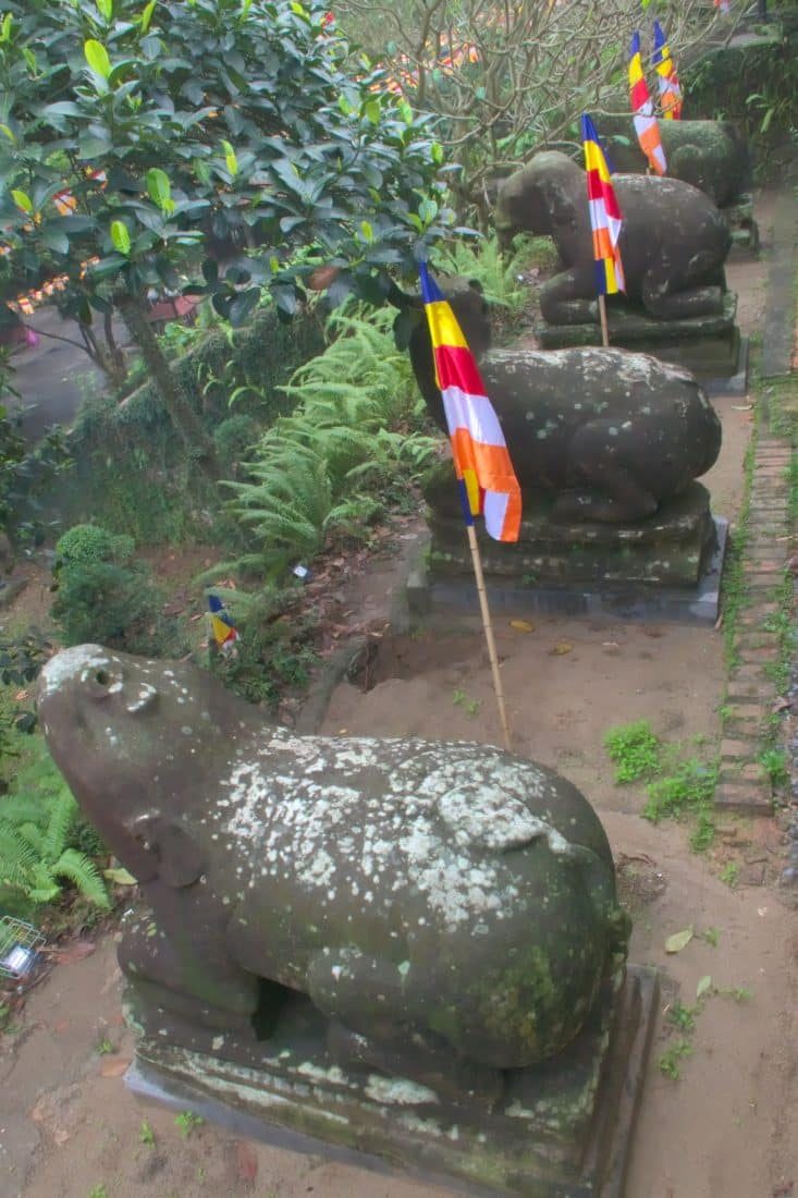 Old stone Animal statues at a Vietnamese temple