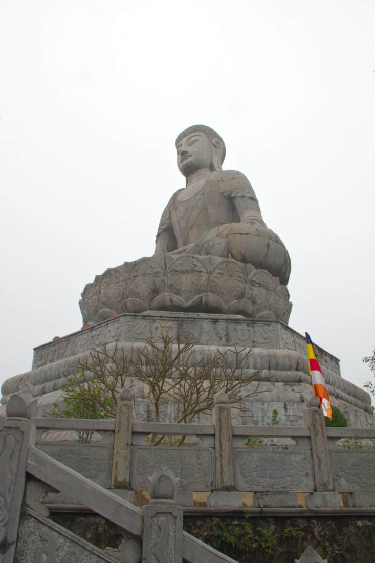 A big buddha statue above stairs in Vietnam