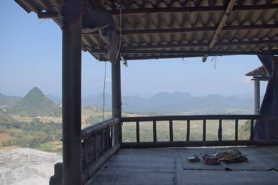 A wooden dining platform with a view from Thung Khe mountain pass, Vietnam