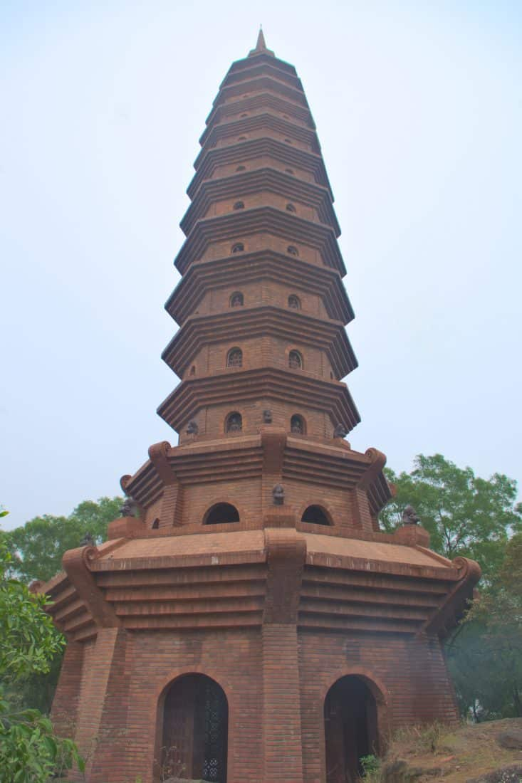 A brown stupa tower contrasting against the sky