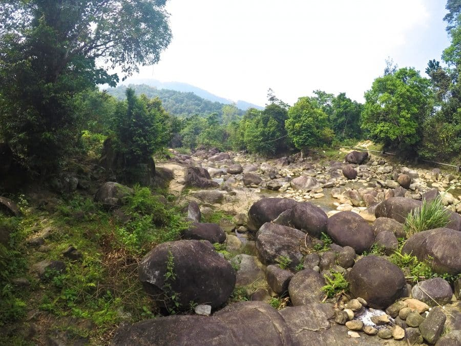 A stream with large boulders in the jungle of Vietnam