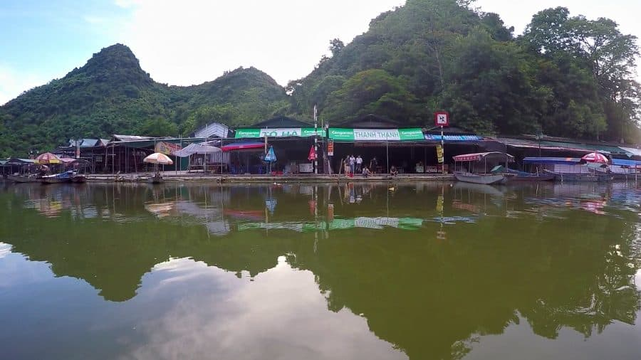 boat docks and a river reflection at a Vietnamese temple in Hanoi
