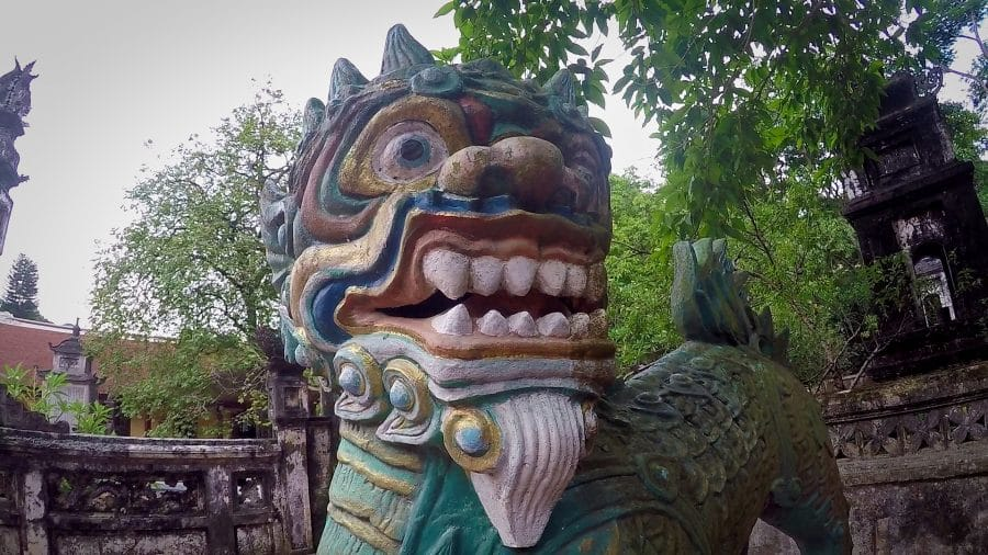 A clourful lion statue at a Vietnamese pagoda
