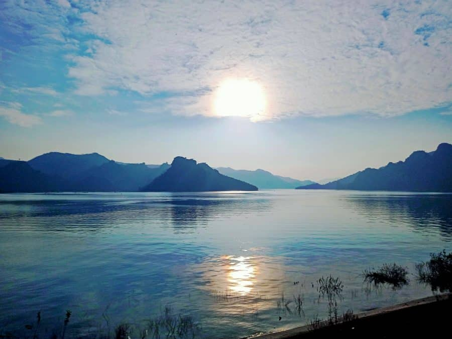 A beautiful resevoir of blue water and mountains at sunset in Hoa Binh