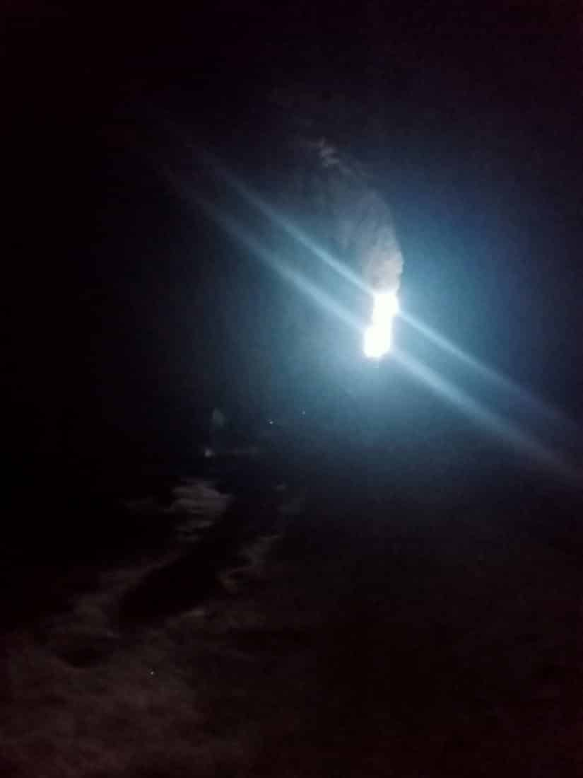 The light of a cave mouth from deep within a cave