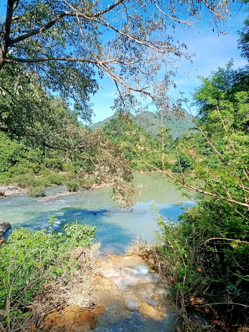 A pretty blue river though the trees in Dien Bien Province