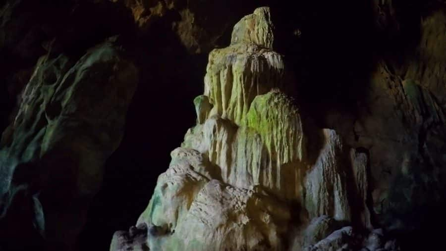 A cave stalagmite with lovely green and white colourations in Dien Bien, Vietnam.